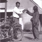 A young Barney Rush welcomes a competitor in the 1925 RACV Reliability Trial
